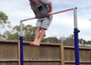 Daughter tries to teach her dad gymnastics